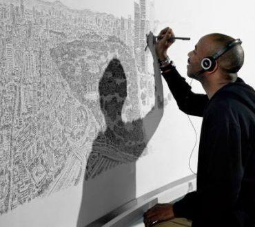 Καλλιτέχνης με αυτισμό ζωγραφίζει ολόκληρες πόλεις με λεπτομέρεια από μνήμης (Βίντεο)